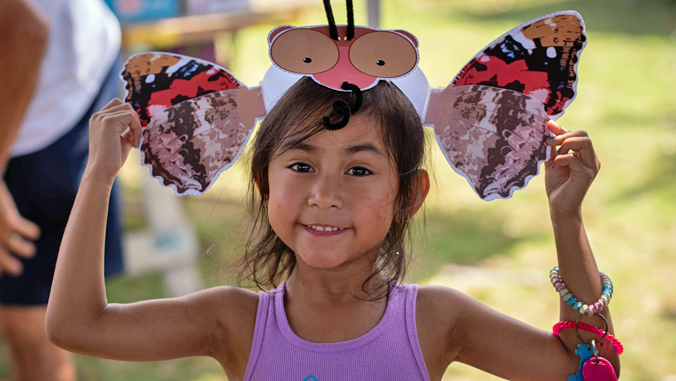 girl wearing butterfly hat