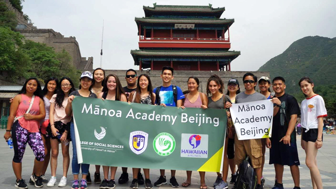 group of students in front of a historic building in China