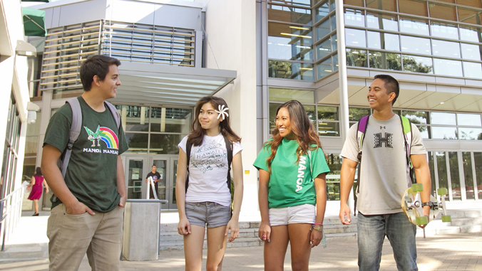 four students standing outside the U H Manoa Warrior Rec Center