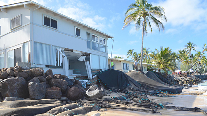 Damaged homes on the shoreline