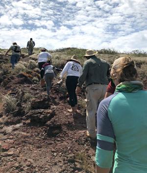 people climbing up steep hill on Kahoolawe