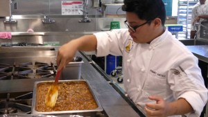 culinary student making stew