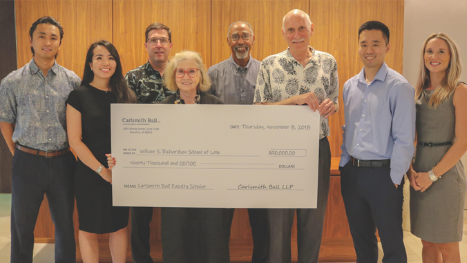 Group photo with giant ceremonial check