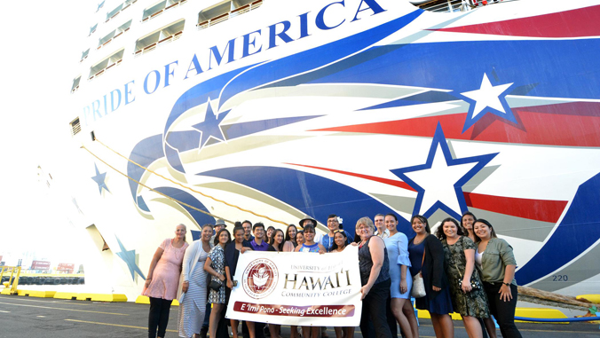 students and teachers posing in front of cruise ship
