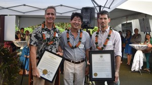 three males holding certificates from the Honolulu City Council