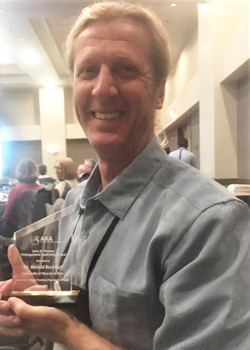 professor with his award