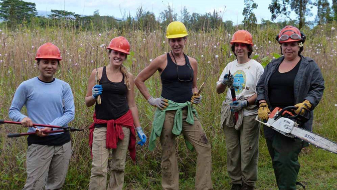 five women smiling with tools