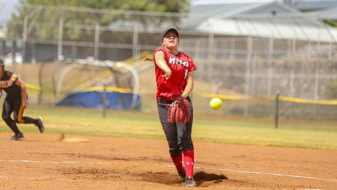 student playing softball