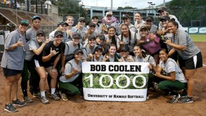 softball team holding a sign that says Bob Coolen 1000