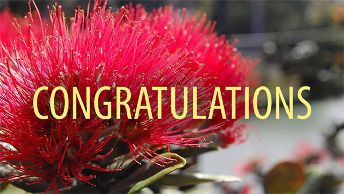 Congratulations, with lehua flower in background