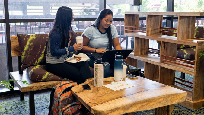 two U H Hilo students sitting in library lounge
