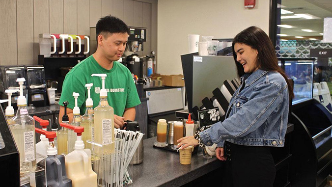 Two people at the Starbucks counter