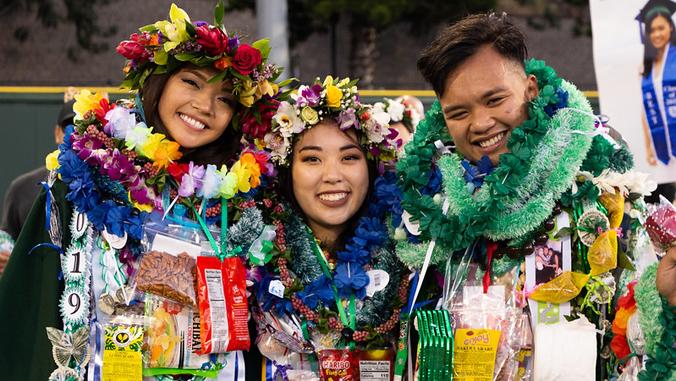 3 U H Manoa graduates wearing lei