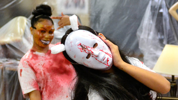 college students in halloween masks