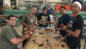 students making copper roses