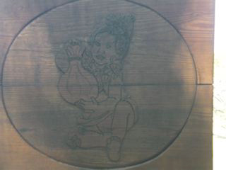 Images of Hawaiiana are once again visible along the wooden fencing.