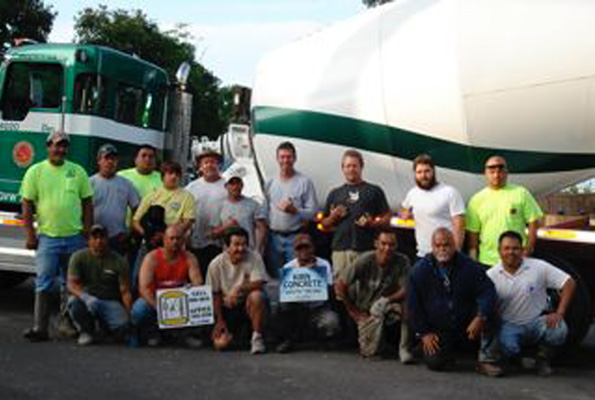 The men who completed the sidewalk and handicap parking - 28 yards of concrete! (Photo courtesy of Cliff Kopp)