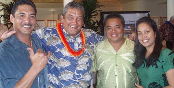 Kerry Okinishi, Mayor Billy Kenoi, Cary Cantere, and Brandee Menino share a moment at the Hawaii Island United Way fundraiser. (Photo special to Hawaii 24/7 by Margaret Masunaga)