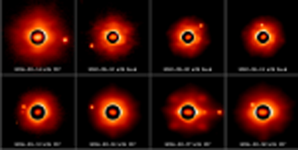 Sylvia and its moons as seen from the 8-10m class telescopes with adaptive optics. The dark circle shows the irregular shape of the asteroid. The small moons can be seen at various positions on these images. More than 66 observations were collected, some were recorded by our team others were extracted from Keck Observatory, Gemini and VLT archive data. (Photo courtesy of Franck Marchis)