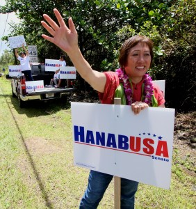 Rep. Colleen Hanabusa signwaves  on Kahakai Blvd on Friday (Aug 15) in Puna on the morning of the delayed primary election for two Puna precincts. Photography by Baron Sekiya | Hawaii 24/7