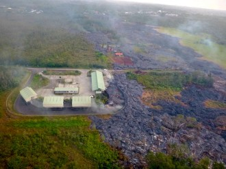 The lower level driveway behind the Pahoa Transfer Station chutes is filling with lava from the Kilauea June 27th Lava Flow on Thursday, November 13, 2014. Photo courtesy of Hawaii County Civil Defense