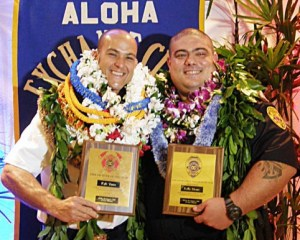 Fire Prevention Inspector Kyle Vares and Vice Officer Kelly Moniz display plaques from the Aloha Exchange Club of East Hawaiʻi.