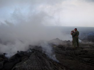 After establishing an appropriate location to resume Very Low Frequency (VLF) measurements over the June 27th lava tube to estimate the cross-sectional area of lava within the tube, HVO geologists make the measurements, sometimes requiring walking through volcanic gases. Photo taken Tuesday, March 17, 2015 courtesy of USGS/HVO