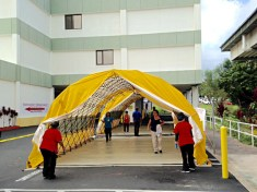 Kona Community Hospital personnel deploy emergency triage tents.