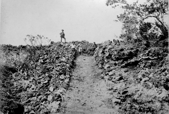 The 1887 lava flow erupted from Mauna Loa's Southwest Rift Zone crossed the government road (about a 1,000 feet south of today's Highway 11), traveling 14 km (9 mi) in less than 9 hours. Photo by J.J. Williams, courtesy of National Park Service.