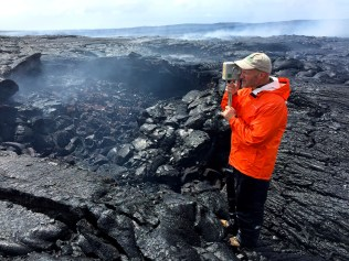 HVO geologist conducts a VLF (very low frequency) survey across the episode 61g lava tube to measure the depth and cross-sectional area of lava flowing within the tube. Photo taken Friday, August 19, 2016 courtesy of USGS/HVO