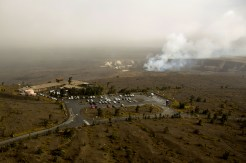 The U.S. Geological Survey Hawaiian Volcano Observatory and the National Park Service Jaggar Museum are perched together near the summit of Kīlauea, about 1.7 km (~1.1 mi) from the lava lake in Halemaʻumaʻu, producing a plume in the background. Photo taken Tuesday, November 29, 2016 courtesy of USGS/HVO