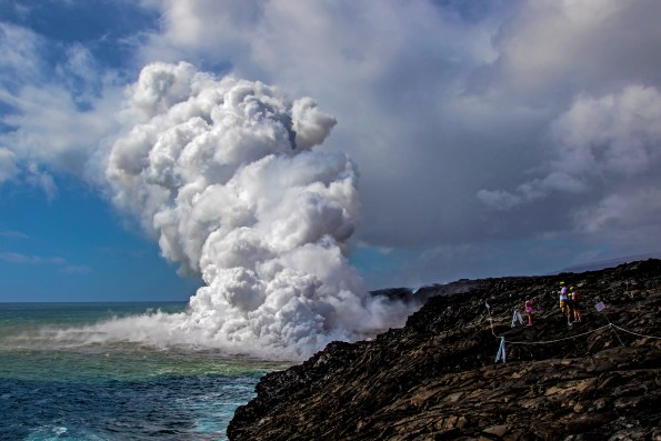 A large plume of rock debris and gas emanates from the Kamokuna lava ocean entry within Hawaii Volcanoes National Park, just moments after the lava delta began to collapse. NPS Photo