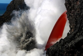 An open lava stream continues to pour out of the lava tube, perched high on the sea cliff, and into the ocean. The stream was remarkably steady today, but produced pulsating littoral explosions that threw spatter onto the sea cliff. Photo taken Saturday, January 28, 2017 courtesy of USGS/HVO