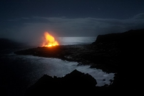 Glow from an active ocean entry on Kīlauea Volcano's Kamokuna lava delta was visible on the evening of September 27, when the 2017 delta was near its maximum size of 8-10 acres. Since then, the edges of the delta began to crumble into the sea. With no lava entering the ocean since November, ocean waves slowly erode the lava delta, further reducing its size. USGS image.