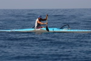 """Jackie Rey's Relay Canoe Race first place finisher, Kua Nolan on his V-1 Rudderless Canoe. Kua completed the 12 mile course in 1:56:02 as an """"Iron"""" paddler, meaning he chose not to  tag off a partner at Kailua Pier, but to paddle the entire distance solo. Photo by Susan Anderson"""