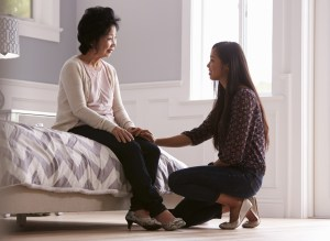 Adult Daughter Talking To Depressed Mother At Home