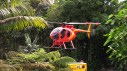 The Hawaii County Fire Department Chopper One airlifted divers in and out of the Wailuku River Saturday morning (March 31) Crews spent a second day searching for a missing swimmer. Photography by Baron Sekiya | Hawaii 24/7