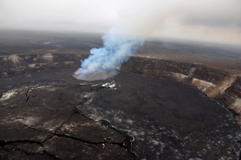 As of this afternoon (May 1), the eruption at the summit of Kīlauea has apparently not been affected by the collapse at Pu'u 'Ō'ō or intrusion of magma along the volcano's Lower East Rift Zone. Following multiple overflows of the summit lava lake on April 21-27, which spilled lava onto the floor of Halema'uma'u, the lava lake level dropped over the weekend (April 28-29). But on the morning of April 30, the lava lake level began to rise in concert with summit inflation. This image of the summit lava lake was taken during HVO's overflight just before 8 a.m. today. Photo taken Tuesday, May 1, 2018 courtesy of U.S. Geological Survey