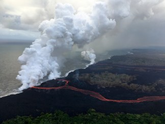 During today's overflight of the ongoing lower East Rift Zone eruption, HVO geologists noted that fissures 6, 13 and 22 were still erupting, with two channelized flows reaching the ocean. The eastern lava channel splits just before reaching the ocean, so it has two entry points, creating a total of three ocean entries on the flow field. USGS photo by M. Patrick.