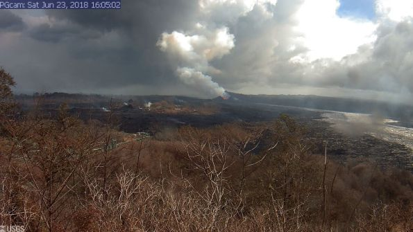 This image is from a temporary research camera positioned near Kapoho looking southwest. From left to right, one can see the eruptive fissures, with Fissure 15 on the far left, and Fissure 8 near the center.Webcam image taken Saturday, June 23, 2018 courtesy of U.S. Geological Survey