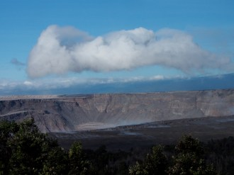 Misty weather is coming and going this morning at the summit of Kīlauea. A break in the mist allowed this clear view of Halema'uma'u from the northeast rim of the caldera, from which talus (rock fragments) piled at the base of the steep crater walls can be seen. With each summit collapse. rocks in the crater walls are shaken loose, widening the crater. Since May 16, 2018, the crater depth has more than tripled and the diameter has more than doubled. Photo taken Saturday, August 4, 2018 courtesy of U.S. Geological Survey