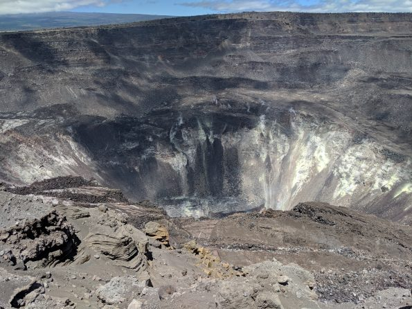 Only small amounts of sulfur dioxide (SO2) and hydrogen sulfide (H2S) are currently being released from Kīlauea, but those gases chemically react with each other to form the bright yellow sulfur deposits on the crater walls within Halema'uma'u. HVO's April 4 Volcano Watch article addresses a study of gas emissions before and after the end of the 2018 lower East Rift Zone eruption. USGS photo by M. Poland, 03/22/2019.
