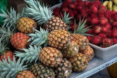 Farmers Market Hawaii - Pineapples & Rambutans on a stand
