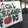 Local Organic Foods sign at permaculture farmers market