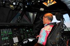 Gerard Akaka, the Vice President of Medical Affairs with the Queen's Medical Center, scans the area ahead of him as he flies in the UH-60 Black Hawk simulator during a visit to the 25th Combat Aviation Brigade, 25th Infantry Division to learn about the Army's risk management process for its pilots on Wheeler Army Airfield, Hawaii, June 12.