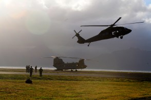 A UH-60 Black Hawk assigned to Company B, 2nd Battalion, 25th Aviation Regiment, 25th Combat Aviation Brigade, deploys the Special Patrol Insertion and Extraction rope in a demonstration for Navy divers with the U.S. Navy SEAL Delivery Vehicle Team 1, Naval Special Warfare Group 3 during SPIE training with flight crews from the 25th Combat Aviation Brigade at Marine Corps Air Station Kaneohe Bay June 18.