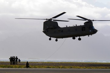 Navy divers with the U.S. Navy SEAL Delivery Vehicle Team 1, Naval Special Warfare Group 3 are lifted using the Special Patrol Insertion and Extraction rope attached to a CH-47F Chinook assigned to 3rd Battalion, 25th Aviation Regiment, 25th Combat Aviation Brigade during SPIE training with flight crews from the 25th CAB at Marine Corps Air Station Kaneohe Bay June 18.