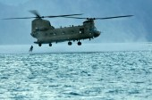 A CH-47F Chinook assigned to Company B, 3rd Battalion, 25th Aviation Regiment, 25th Combat Aviation Brigade prepares to drop Navy divers with the U.S. Navy SEAL Delivery Vehicle Team 1, Naval Special Warfare Group 3 in the water during HELOCAST training with flight crews from the 25th CAB at Marine Corps Air Station Kaneohe Bay June 18.