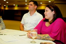 Sergeant Jodi Barnes (left), Headquarters and Headquarters Company Training Noncommissioned Officer, 25th Combat Aviation Brigade, and wife Amber listen to techniques on how to communicate effectively in a marriage while attending the 25th CAB Strong Bonds Marriage Retreat at the Hale Koa Hotel in Honolulu June 27.