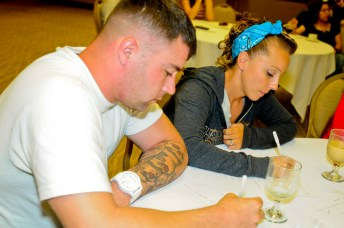 Staff Sergeant Brandy Gately, a spectrum manager assigned to Headquarters and Headquarters Company, 25th Combat Aviation Brigade, and husband Staff Sgt. Adam Gately, a spectrum manager with the 45th Sustainment Brigade, brainstorm family statements while attending the 25th CAB Strong Bonds Marriage Retreat at the Hale Koa Hotel in Honolulu June 27.